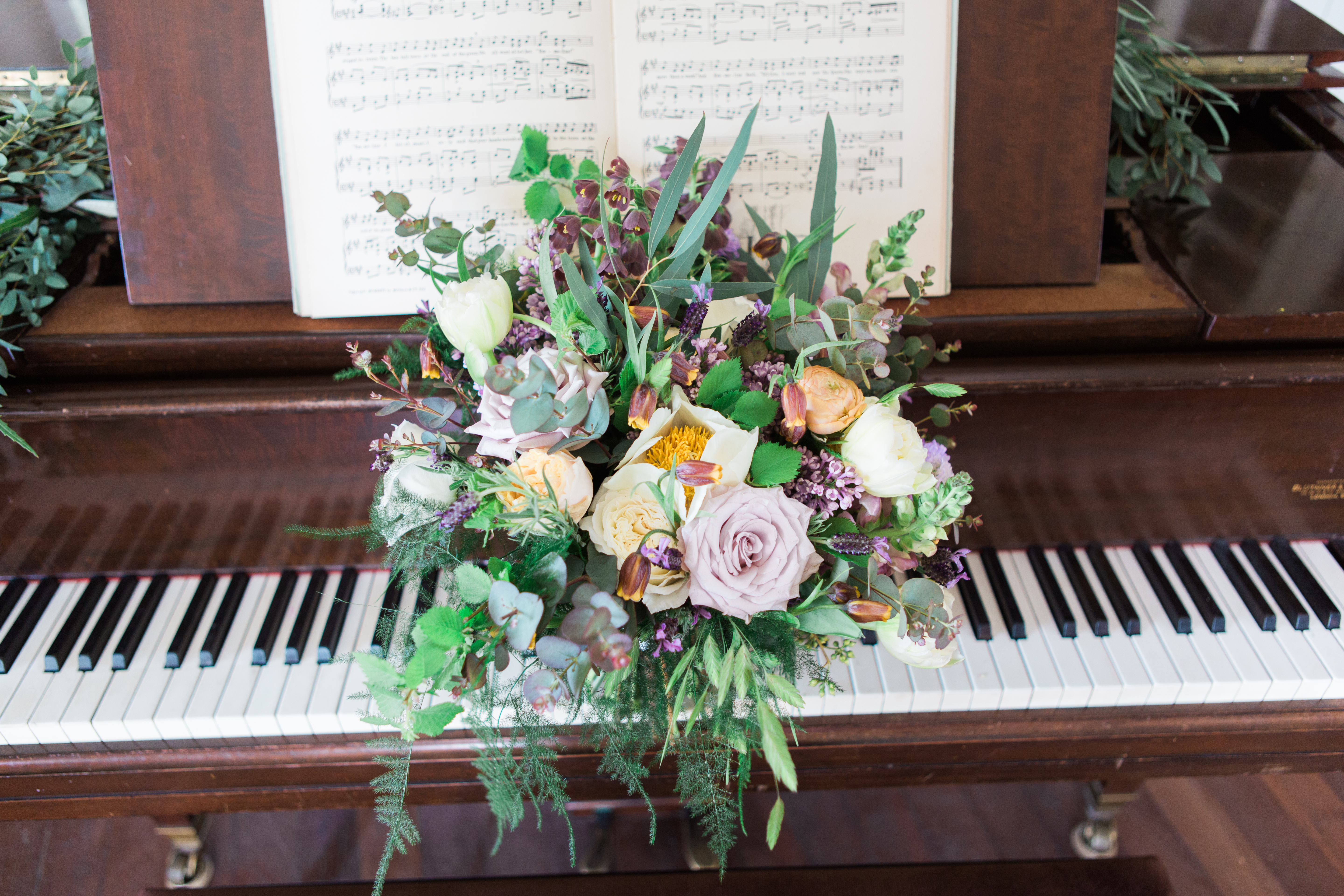 Piano with wedding flowers